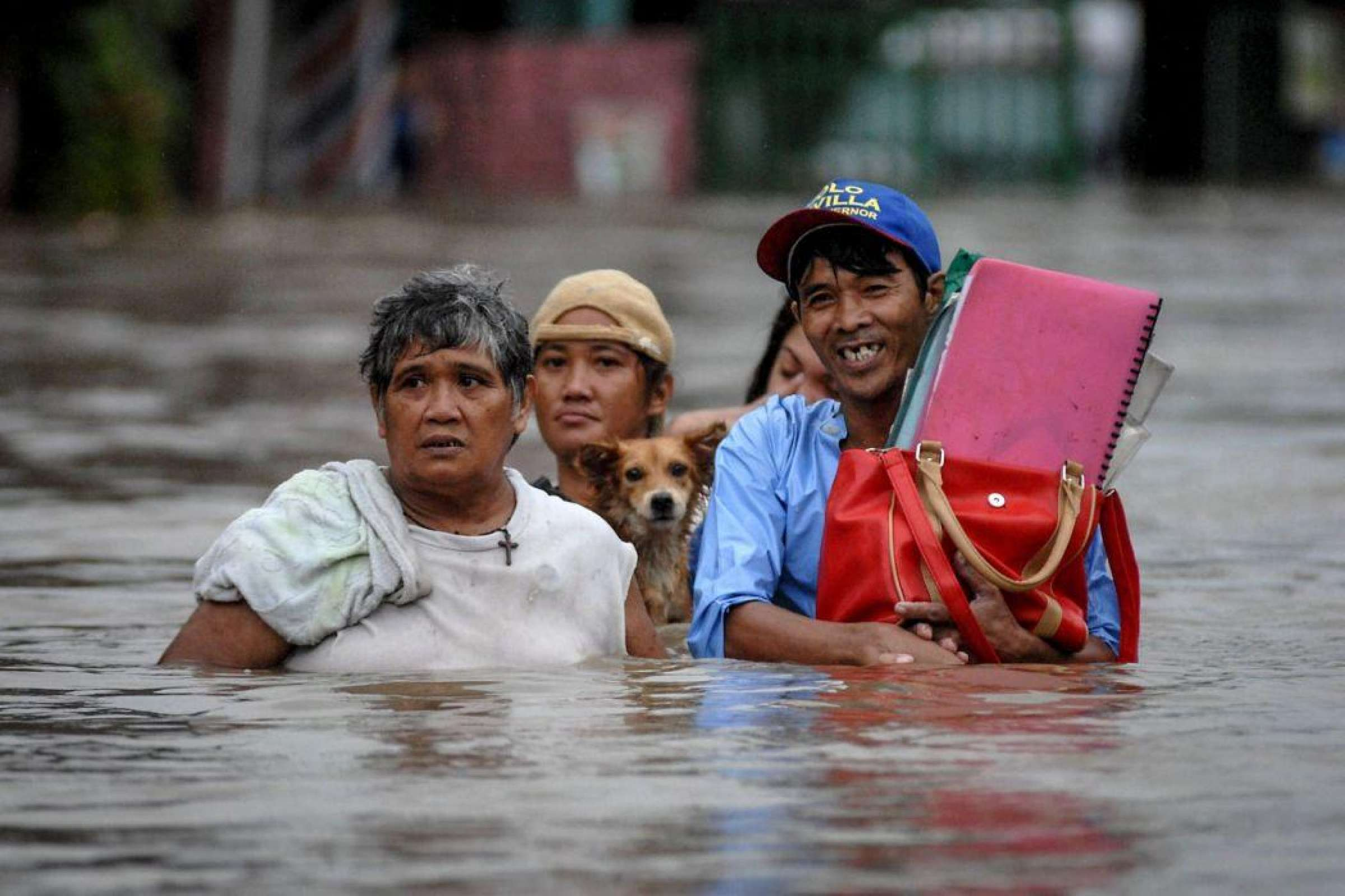 Dog And Family In The Philippines In Flood